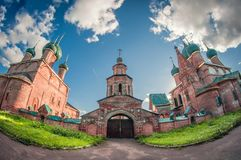 Classic old small monastery cathedral and church in Russia. distortion perspective fisheye lens stock images