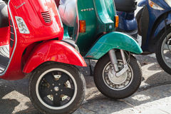 Classic old style Vespa scooters stands parked. Casamicciola Terme, Italy - August 12, 2015: Classic old style Vespa scooters stands parked on a roadside Royalty Free Stock Photography