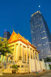 Classic old temple view contrast with modern skyscraper building Royalty Free Stock Photo