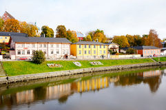 Classic old wood houses and their reflection in river. Porvoo, Finland Stock Photography