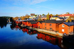 Classic old wood houses and their reflection in water. View of old town near the river in autumn, Porvoo Finland Stock Photo