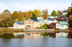 Classic old wood houses and their reflection in water Stock Photos