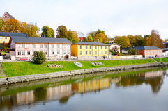 Classic old wood houses and their reflection in water. View of old town near the river in autumn, Porvoo Finland Stock Photography