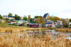 Classic old wood houses and their reflection in water. View of old town near the river in autumn, Porvoo Finland Stock Photos