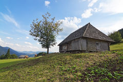 Classic old wooden house in a landscape. Stock Photos