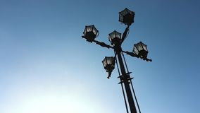 Classic older lamp and blue sky. Old fashioned street light against a blue sky. Vintage style street lights by the day.  stock video footage