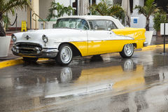 Classic Oldsmobile with chrome radiator grill parked in front of Royalty Free Stock Image