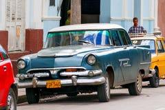 Classic oldtimer car parked on street. Havana, Cuba. Royalty Free Stock Photos