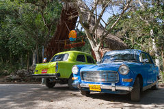 Classic oldtimer car parking near trees. Cuba. Royalty Free Stock Photos