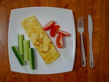 Classic omelet with tomatoes and cucumbers on the white plate.. Fresh breakfast Royalty Free Stock Photography