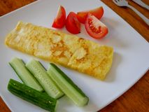 Classic omelet with tomatoes and cucumbers on the white plate.. Fresh breakfast Royalty Free Stock Photo