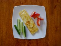 Classic omelet with tomatoes and cucumbers on the white plate.. Fresh breakfast Royalty Free Stock Images