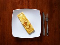 Classic omelet on the white plate. Fresh breakfast.. Classic omelet on the white plate. Fresh breakfast Royalty Free Stock Images