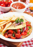 Classic omelete with cherry tomato. Salad and french fries royalty free stock photos