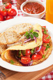 Classic omelete with toasted bread and cherry tomato Royalty Free Stock Photography