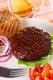 Classic opened beef burger with beer on background royalty free stock images