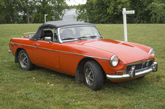 Classic orange MG A Sports motor car. Picture of classic MG A Sports motor car sitting on the grass during the concours d`elegance chambly, July 16-17, 2016 Stock Images