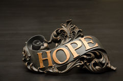 Classic ornate Hope Scroll Decor. With copper accents is a compliment to Faith and Love Royalty Free Stock Photo
