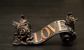 Classic ornate Love Scroll Decor. In copper accents. Companion to Hope and Faith Royalty Free Stock Photos