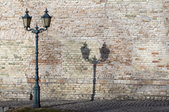 Classic outdoor lamp by the old brick wall. Stock Photos
