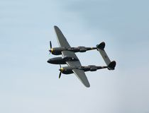 Classic P-38 aircraft. Historic turboprop military aircraft in the air royalty free stock image