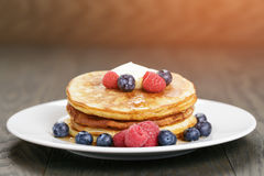 Classic pancakes with butter berrys and maple Royalty Free Stock Image