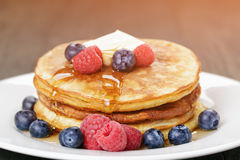 Classic pancakes with butter berrys and maple Stock Photography