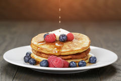 Classic pancakes with butter berrys and maple Stock Images