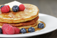 Classic pancakes with butter berrys and maple Royalty Free Stock Photos