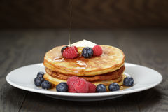 Classic pancakes with butter berrys and maple Royalty Free Stock Photography