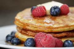 Classic pancakes with butter berrys and maple Stock Photo