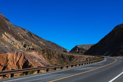 Classic panorama view of an endless straight road running through the barren scenery of the American Southwest stock photo
