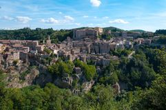 Beautiful classic panoramic view of the ancient town of Sorano in autumn, province of Grosseto, southern Tuscany, Italy Stock Photos