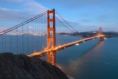 Classic panoramic view of famous Golden Gate Bridge in beautiful evening light on a dusk with blue sky and clouds in summer. Classic panoramic view of famous royalty free stock images