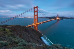 Classic panoramic view of famous Golden Gate Bridge in beautiful evening light on a dusk with blue sky and clouds in summer. Or autumn, San Francisco royalty free stock image