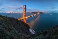 Classic panoramic view of famous Golden Gate Bridge in beautiful evening light on a dusk with blue sky and clouds in summer. Classic panoramic view of famous stock photo