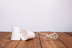 Classic paper cup phone on wood background Stock Photos