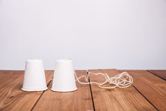 Classic paper cup phone on wood background Royalty Free Stock Photography