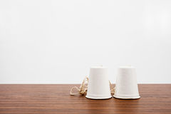 Classic paper cup phone on wood background Royalty Free Stock Photo