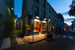 A classic parisian cafe at night. In Montmartre Royalty Free Stock Photos
