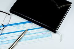 Classic pen on deposit slip Royalty Free Stock Images