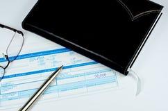 Classic pen on deposit slip. On white Royalty Free Stock Images