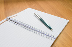 Classic pen and notebook on wooden desk Royalty Free Stock Photography