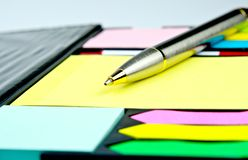 Classic pen on yellow  memos. For background Royalty Free Stock Photo