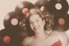 Classic pin up girl on vintage vinyl lp records Royalty Free Stock Photos