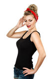 Classic pin-up woman saluting Stock Photo