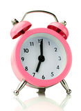 The classic pink alarm clock Stock Images
