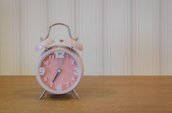Classic pink alarm clock Royalty Free Stock Images