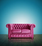 Classic pink leather sofa. And blue background Stock Photo