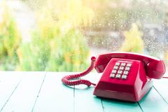 Classic pink telephone receiver stock photo